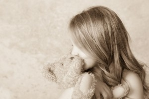 Evergreen Child with teddy bear